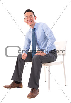 Full body Asian business man sitting