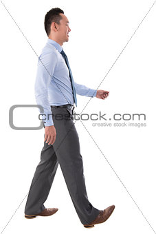 Asian businessman walking