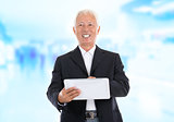 Asian senior businessman using tablet-pc