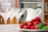 Strawberries and Milk on table in kitchen