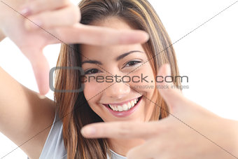 Beautiful woman framing her face with the fingers