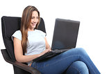 Beautiful woman with a laptop on a couch