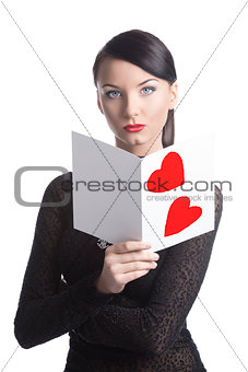 pretty brunette with valentine postcard looks in to the lens