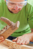 Manual woodwork - man with planer and slat