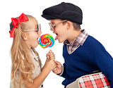 Kids sharing a large lollipop