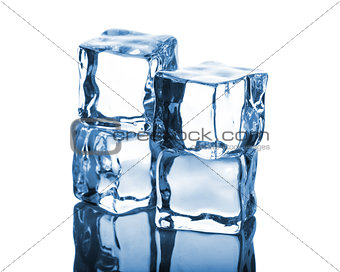 Four ice cubes with reflection