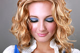 Makeup on a Blonde Woman Looking Down