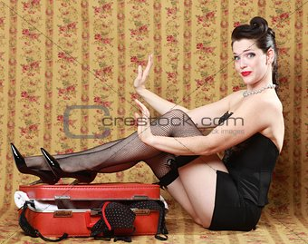 Pin Up Girl in Studio With Luggage