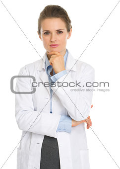 Portrait of thoughtful woman in white robe