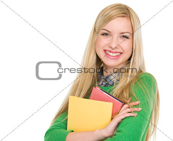 Portrait of smiling student girl with books