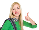 Smiling student girl showing thumbs up