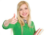 Happy teenage student girl showing thumbs up