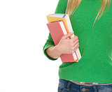 Closeup on student girl with books