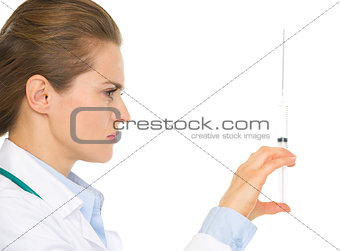 Closeup on medical doctor woman holding syringe