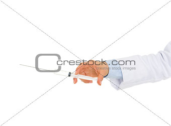 Closeup on hand of medical doctor holding syringe
