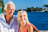 Happy Senior Couple Looking to Tropical Sea or River