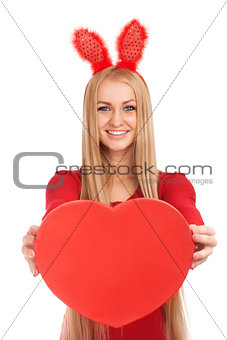 Beautiful young with valentines heart in hands