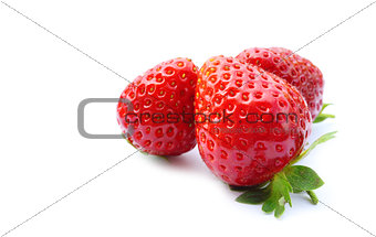 three fresh strawberries on white