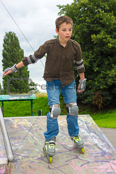 Shot of concentrated sliding rollerskaters in protection kit
