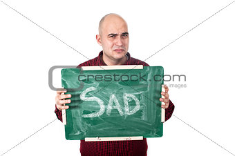 Sad man with chalkboard