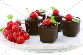 Candy with chocolate and berries.