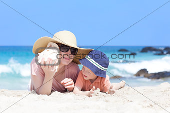 mother and her child at a beach