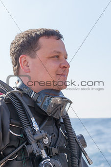 Portrait shot of a scuba diver from the side