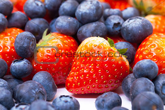 Heap Fresh Strawberries and Blueberries