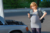 Pregnant Woman Calling for help near the Broken Car