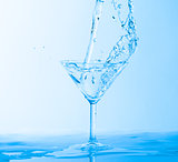 Water Splashing in a Wineglass