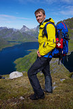 Hiker above fjord