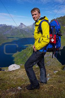 Hiker above fjord