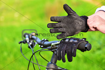 Mountain biker wears old gloves