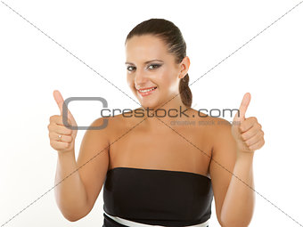 Attractive young brunette businesswoman shows the sign thumbs up