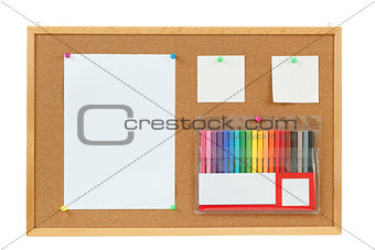 color markers with notes on cork board