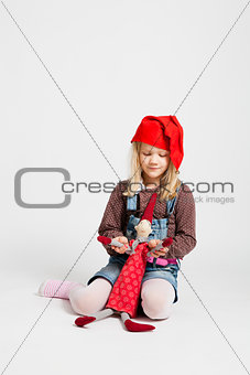 Girl holding Christmas elf doll