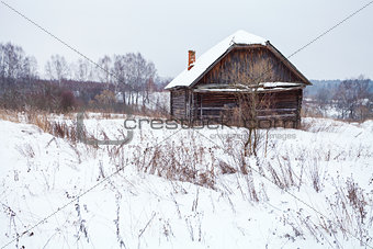 abandoned house in snow-covered village