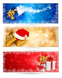 Three christmas banners with gift colorful boxes and snowflakes. Vector illustration