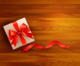 Holiday background with gift box and red ribbons. Vector