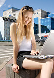 girl with laptop in a hi-tech urban surrounding
