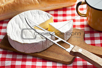 camembert cheese on kitchen table