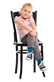 little girl posing on antique chair