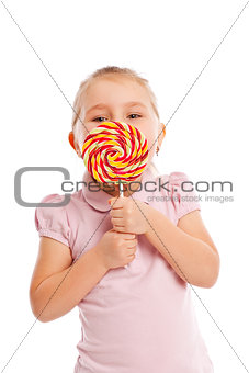 Little girl with a large lollipop.