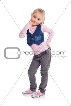 happy little child posing in studio