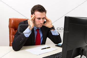 Young concerned businessman