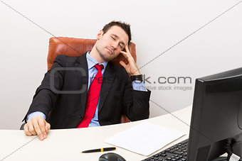 Sleeping businessman at work