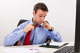 Stressed businessman having a hard day at office