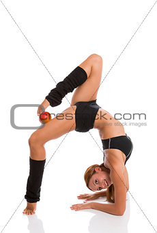 Flexible woman with red apple