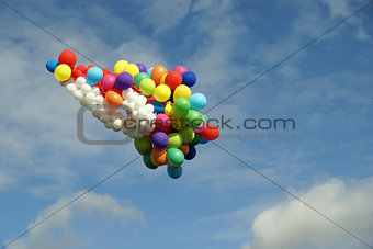 a lot of balloons of flying in sky