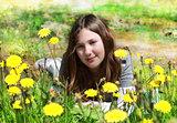 young girl among the flowers